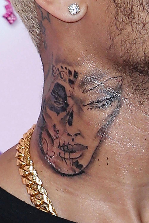13-110912-chris-brown-beaten-up-women-tattoo-lgn_original.jpg