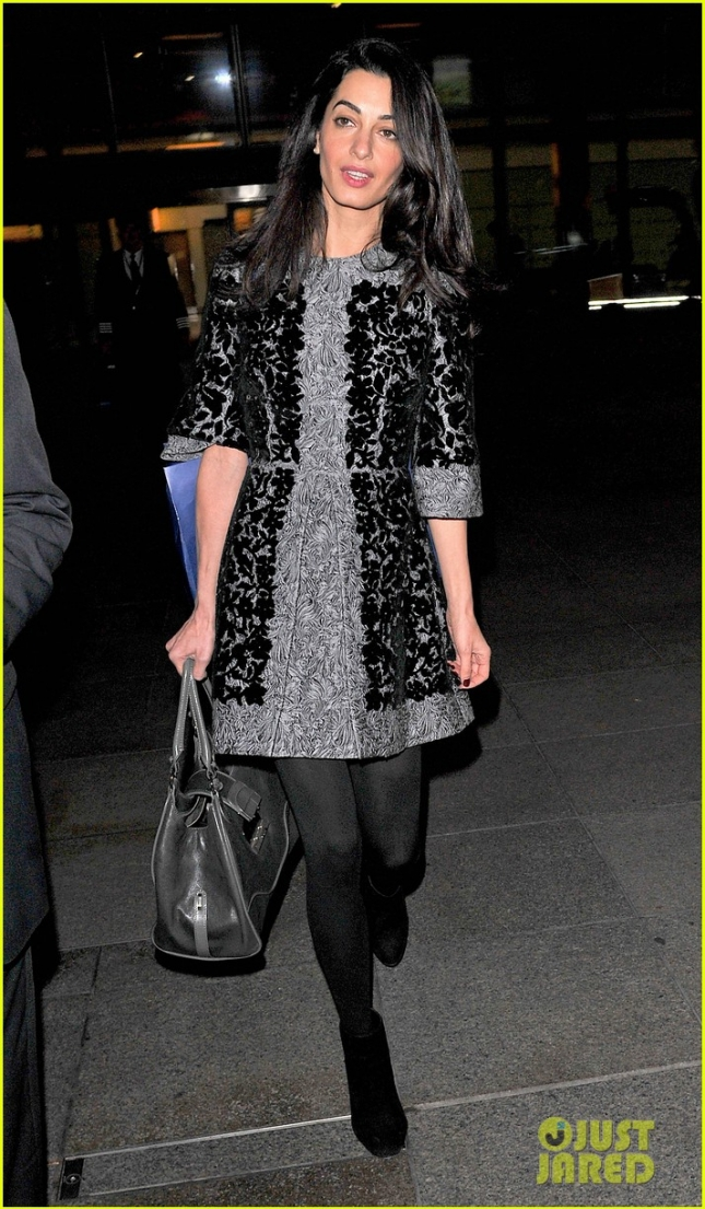 Amal Clooney arrives back in London with class **USA ONLY**