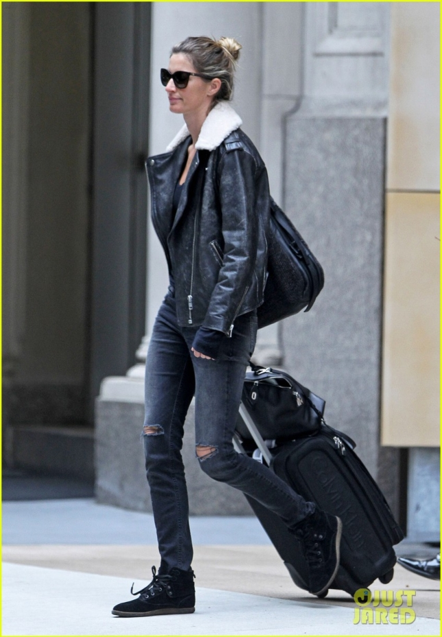 EXCLUSIVE: Gisele Bundchen rocks a leather jacket and rolls a suitcase as she heads out into New York