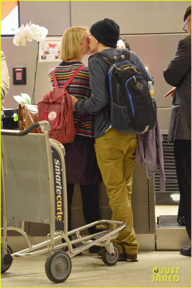 Mia Wasikowska and Jesse Eisenberg show some PDA as they depart at LAX