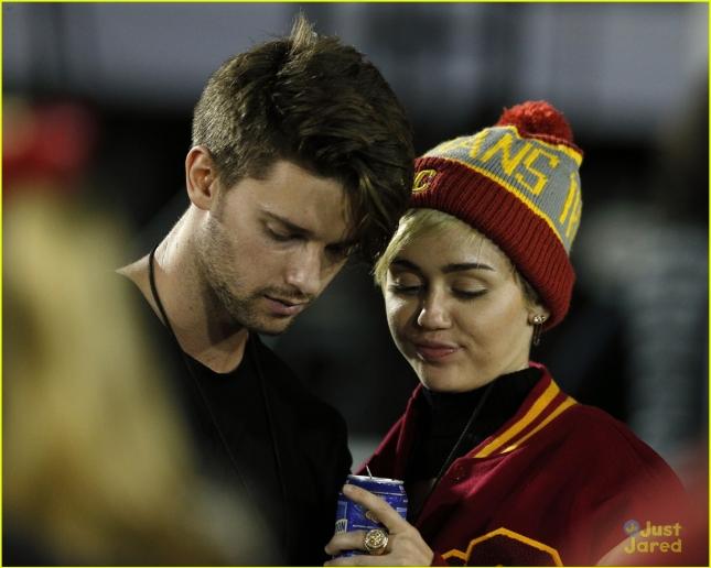Miley Cyrus and Patrick Schwarzenegger sighting at USC football game