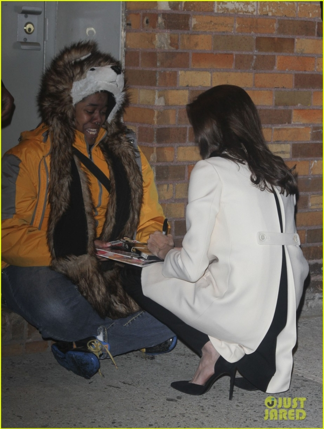Angelina Jolie goes to her knees for a selfie with a crying fan **USA ONLY**