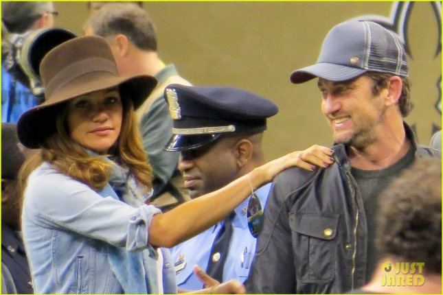 Gerard Butler and girlfriend Morgan Brown attend the New Orleans Saints vs Carolina Panthers football game at the Mercedes Superdome in New Orleans