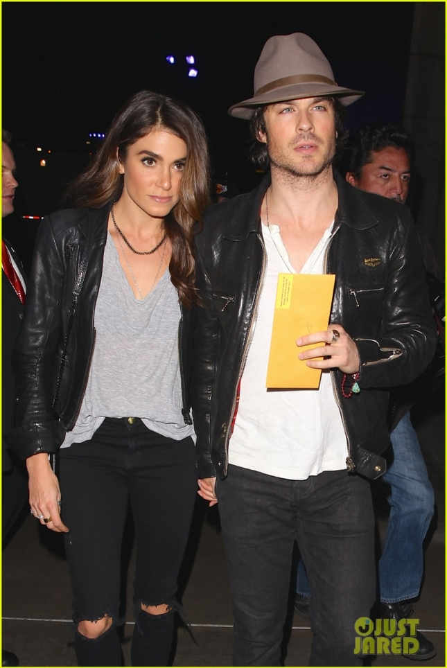 Nikki Reed and Ian Somerhalder hold hands at Staples Center