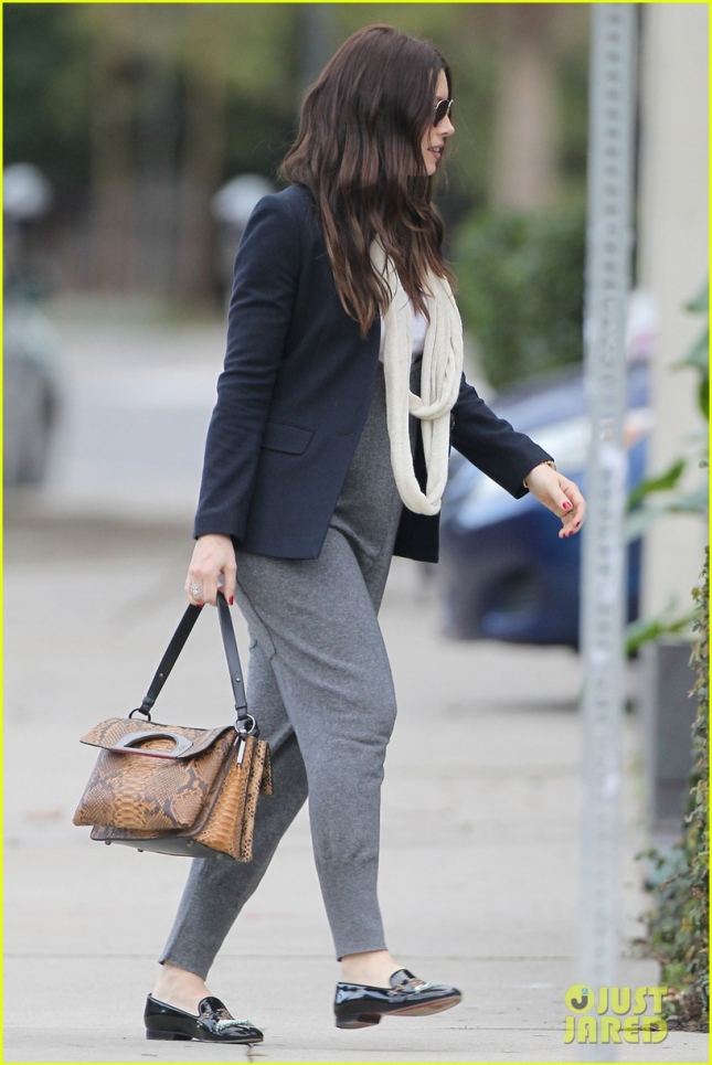 EXCLUSIVE: BABY BUMP! Pregnant Jessica Biel tries to hide her growing tummy in a baggy gray jumpsuit as she leaves a studio in LA