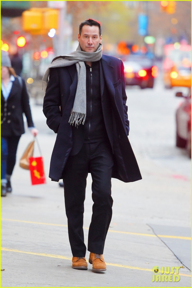 A very dapper Keanu Reeves takes a mid day stroll