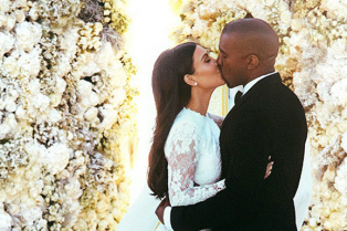 kim-kardashian-kanye-west-wedding_glamour_27may14_E__592x888