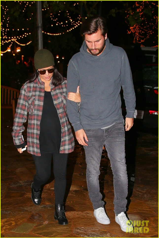 *EXCLUSIVE* Kourtney Kardashian holds the arm of a depressed Scott Disick