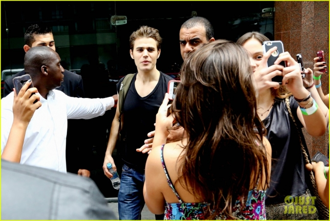 *EXCLUSIVE* Paul Wesley swarmed by fans outside a hotel in Rio