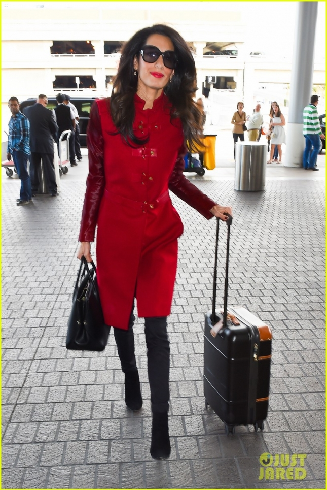 Amal Clooney is a pretty lady in red at LAX Airport **NO UK**