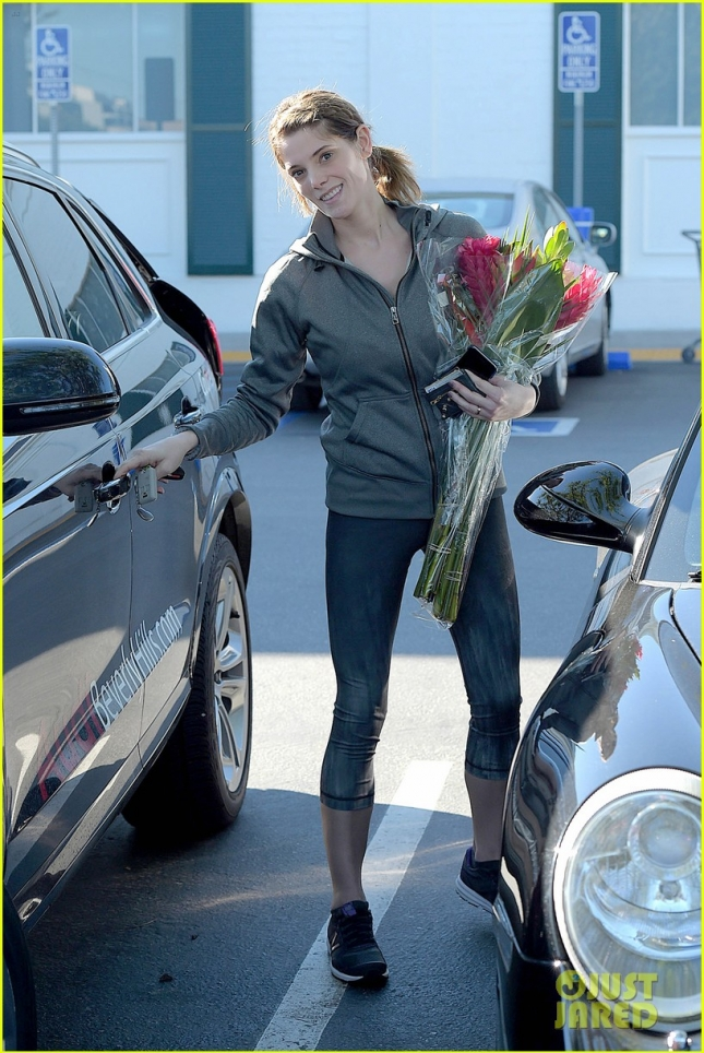 A makeup free Ashley Greene picks up some pretty flowers at the market