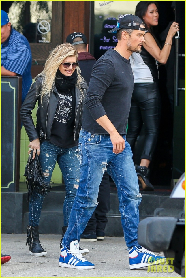 Fergie and Josh Duhamel head out from an LA bar after Seattle wins the finals **USA ONLY**