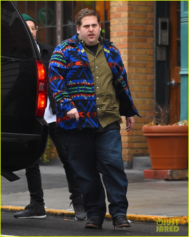 Jonah Hill wearing a colorful pattern sweater and donning a moustache seen running errands in New York City