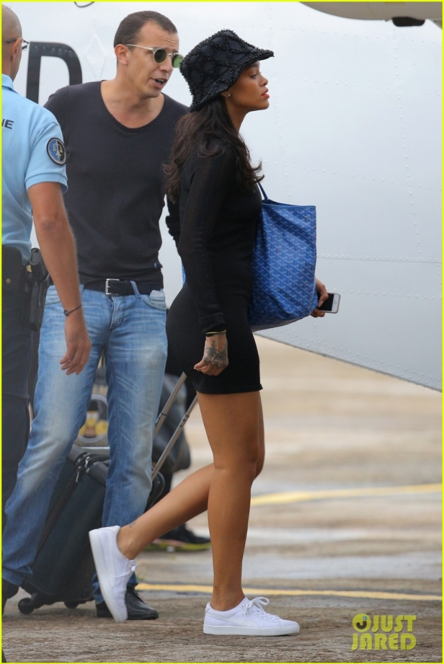 Rihanna jets off in fashionable style on a private plane from St. Barts**USA ONLY**