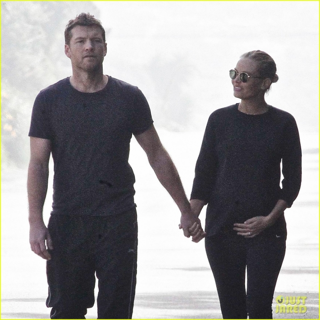 sam-worthington-lara-bingle-cradles-baby-bump-04
