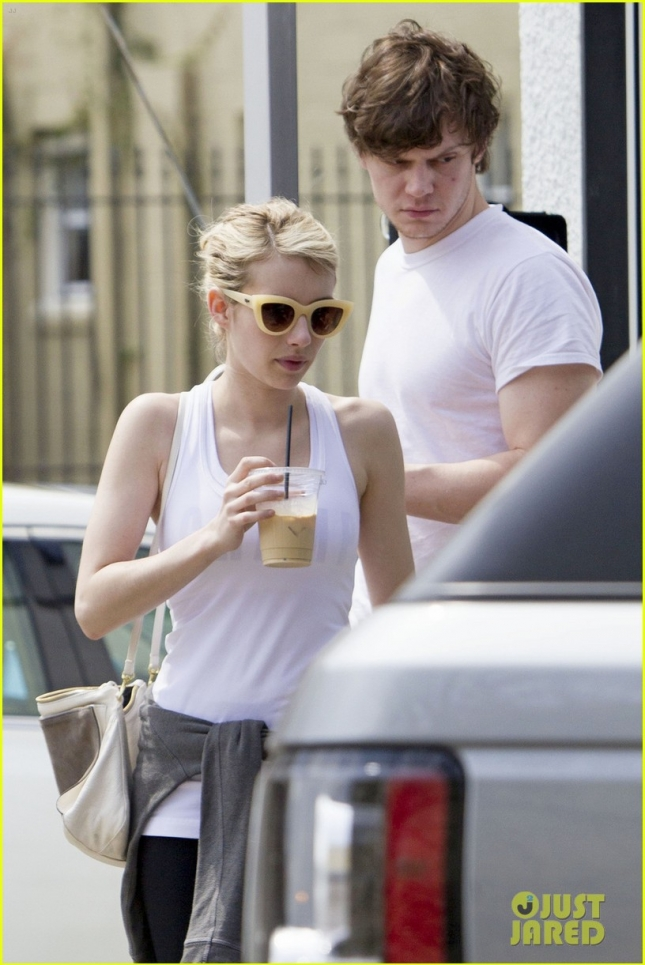 EXCLUSIVE: Emma Roberts and fiance Evan Peters step out without their engagement rings as they grab coffee in New Orleans