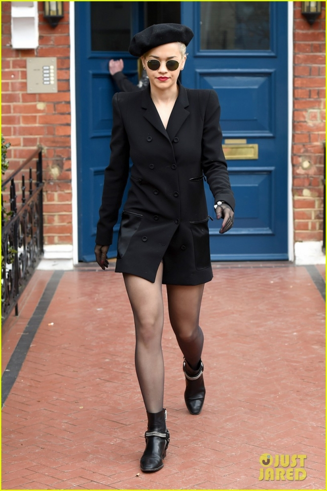 Rita Ora looking dangerous in black leaving her home **USA ONLY**