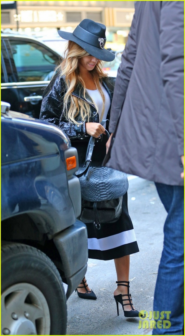 Beyonce Knowles seen out and about in a black and white dress and hat in NYC