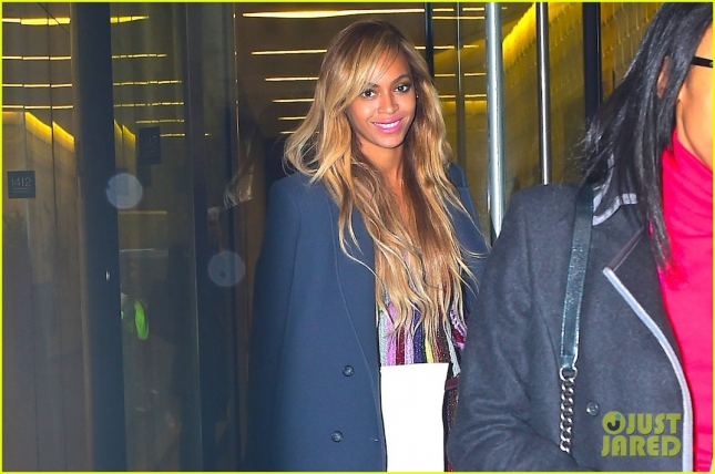 Beyonce wears a rainbow dress as she leaves her NYC office building