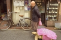 elderly-man-walking-pet-african-spurred-tortoise-sulcata-tokyo-japan-2