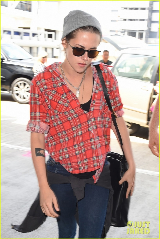 Kristen Stewart gets a bodyguard escort as she makes her way through LAX **NO UK**