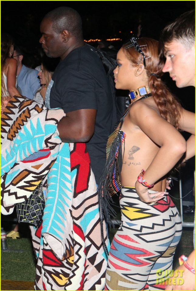 rihanna-covers-up-with-just-a-beaded-necklace-at-coachella-03