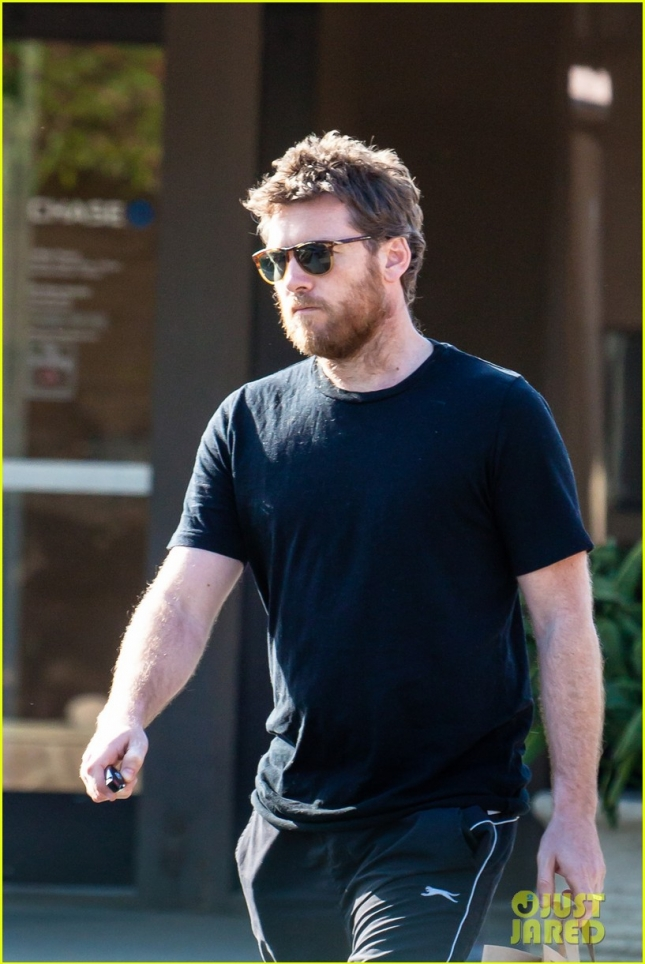 A Scruffy Sam Worthington Picks Up a Bag Full of Burritos