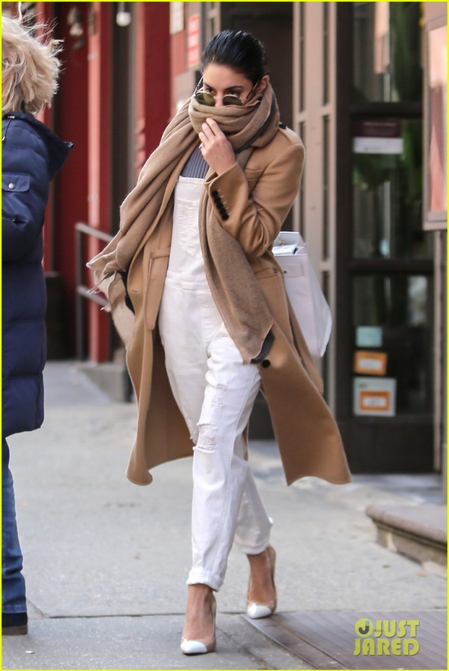 A stylish Vanessa Hudgens covers up on her way to work