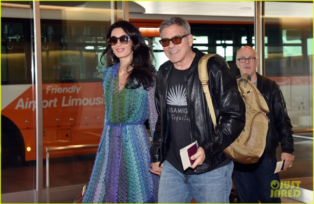 george-amal-clooney-hold-hands-upon-arrival-in-japan-02