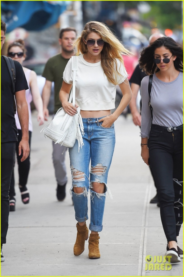 Gigi Hadid bares her midriff as she steps out for lunch with friends