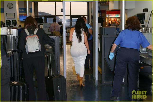 kim-kardashian-wears-form-fitting-dress-to-leave-brazil-30