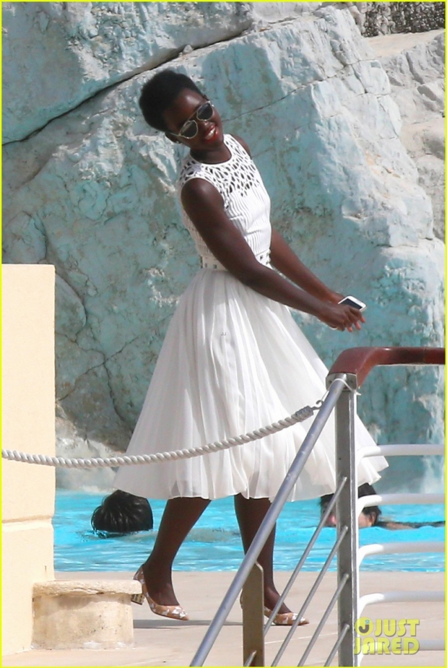Lupita Nyong'o is a vision in white as she enjoys Eden Roc **USA ONLY**