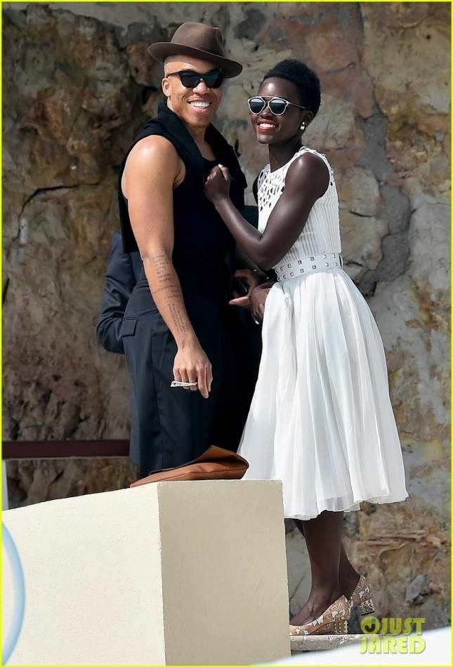 Lupita Nyong'o cuddles up to a mystery man at Eden Roc **USA ONLY**