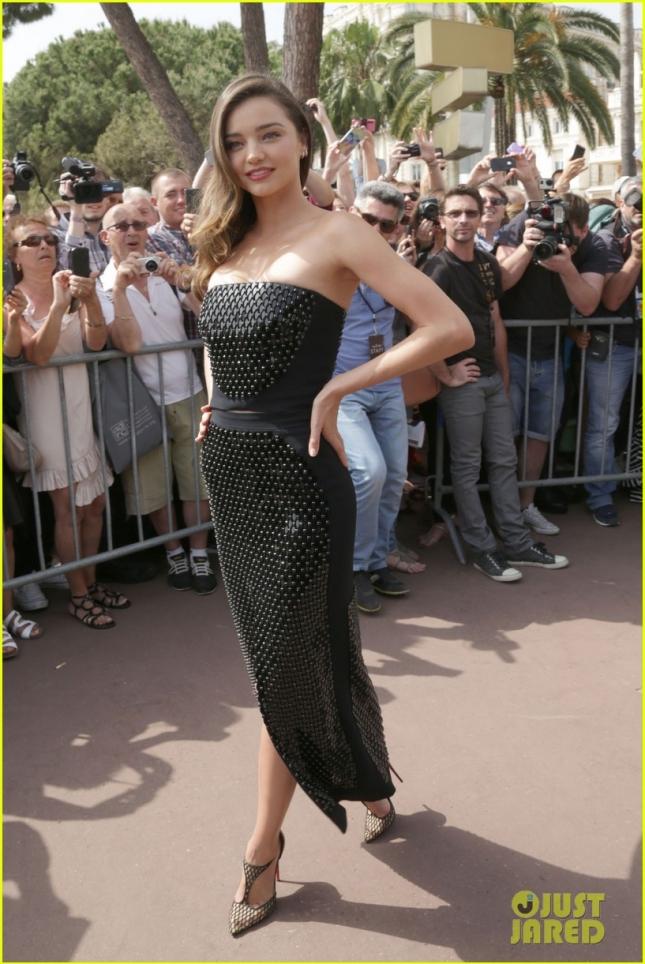 Miranda Kerr rocks an LBD to Magnum Beach **USA ONLY**