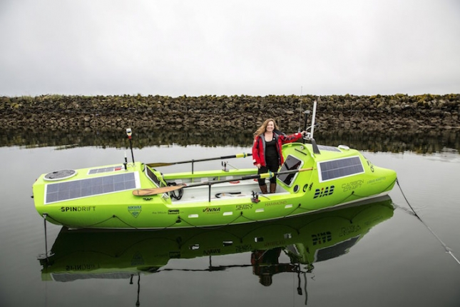 Sonya Baumstein stands in her 23-foot carbon and kevlar solo rowboat in Port Townsend, Washington