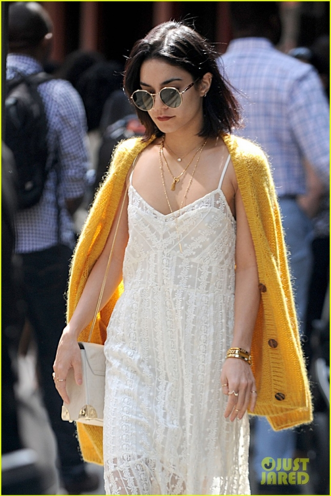Vanessa Hudgens Drapes A Yellow Cardigan Over A Long White Maxi Dress