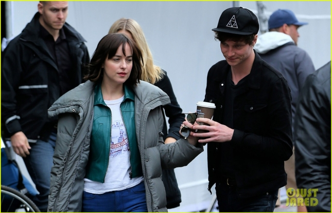 Actress Dakota Johnson holds hands with boyfriend Matthew Hitt as they leave the set of 'How to be Single'