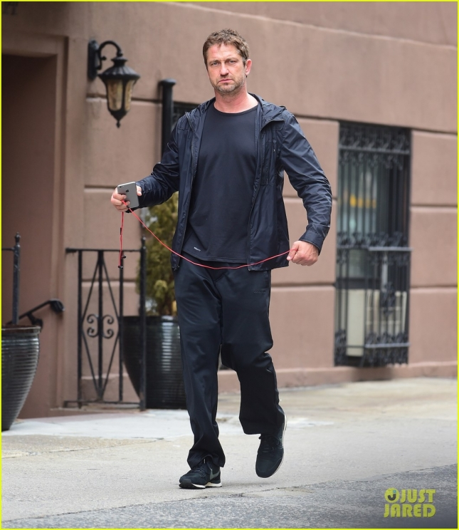 Gerard Butler gives a thumbs up as he strolls in NYC