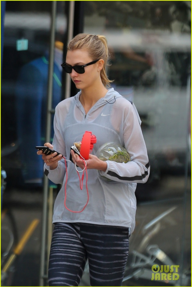 A happy Karlie Kloss heads home after her daily sweat session