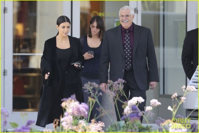 Kim Kardashian gets an escort out of Neiman Marcus after shopping
