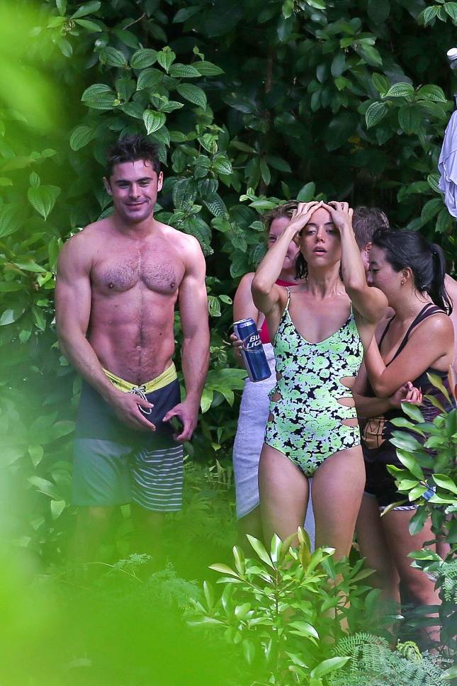 EXCLUSIVE: Zac Efron and Adam DeVine swing shirtless into a Lake **NO WEB, WEB EMBARGO UNTIL 9 AM PST ON 06/16/15**