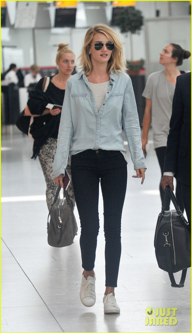 *EXCLUSIVE* Rosie Huntington-Whiteley is casual cute arriving at Heathrow Airport **USA ONLY**