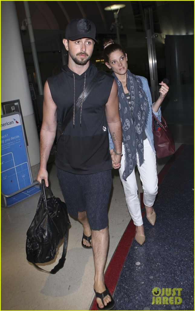 Ashley Greene holds on tight to boyfriend Paul Khoury at LAX **USA ONLY**
