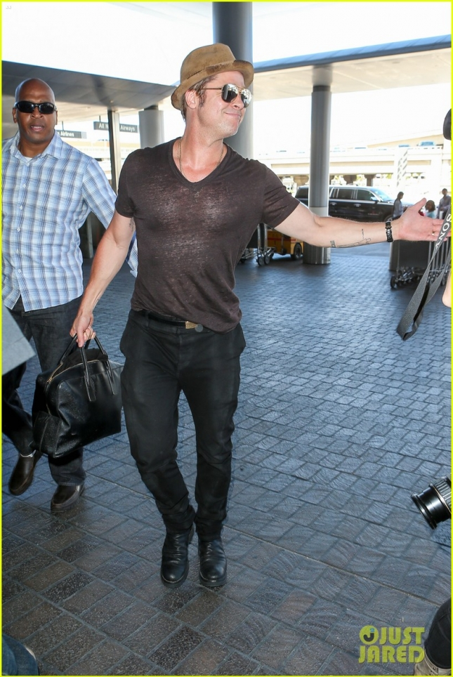 Brad Pitt racks up his frequent flier miles as he jetsets again from LAX **USA ONLY**