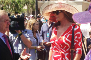 caitlyn-jenner-wears-short-red-dress-for-del-mar-racetracks-opening-01