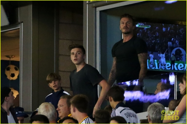David Beckham watches Steven Gerrards LA Galaxy debut with his sons.