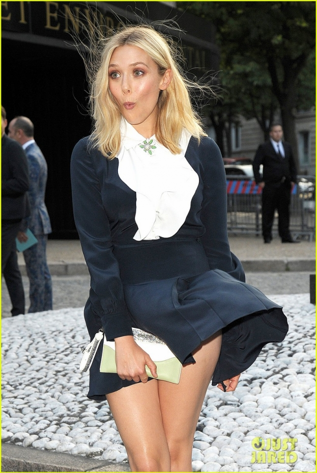 Elizabeth Olsen gets caught up in the wind in Paris **USA ONLY**