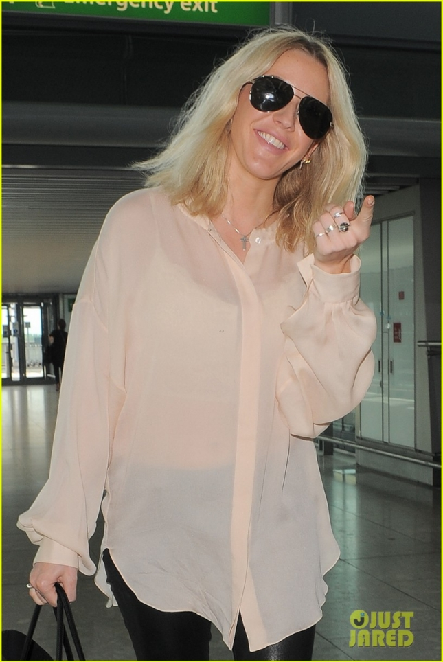 Ellie Goulding is looking beautiful arriving at Heathrow Airport **USA ONLY**