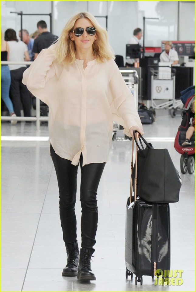 Singer Ellie Goulding is all smiles as she arrives at Heathrow Airport **USA ONLY**