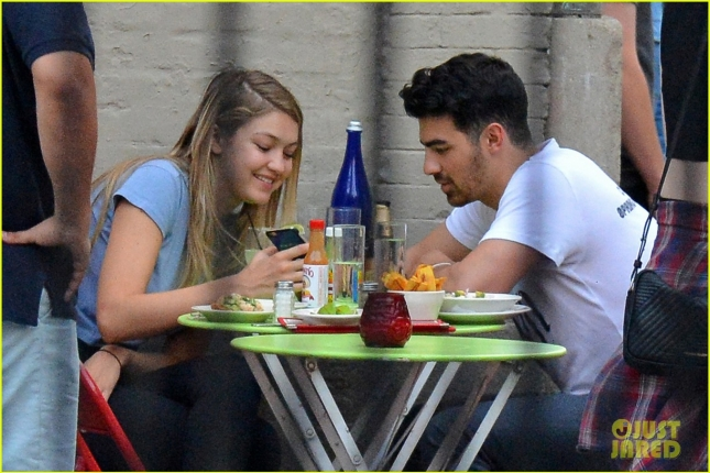 EXCLUSIVE: Gigi Hadid and Joe Jonas share a kiss after eating together at La Esquina restaurant in NYC